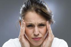 Головная боль - симптом грыжи позвоночника