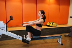 Польза гребного тренажера для спины